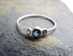 This dainty sapphire ring is handmade from sterling silver in my London studio. The beautiful blue sapphire measures 3mm across and is set in a