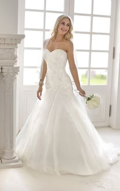 Fabulous fit and flare designer drop waist wedding gown from Stella York (Style 5799)