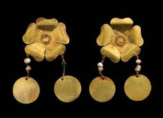 First century earrings from a tomb in Tillia Tepe, Afghanistan. | Thierry Ollivier/Muse Guimet/Getty Images