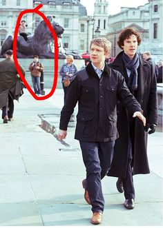 Sherlock was photobombed by Dan and Phil # in the vid    A day in the life of dan and phil in London
