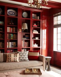 The bookcases of an Upper West Side library designed by Pappas Miron are painted in Benjamin Moore's Cottage Red, and the walls are a custom shade by specialty painter Kenneth Widener.