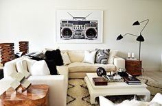 Bold neutral living space with a cream sectional, pop art, and a modern floor lamp