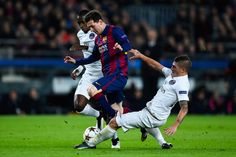 Lionel Messi of FC Barcelona competes for the ball with Blaise Matuidi (L) and Marco Verratti of Paris Saint-Germain FC during his team's first goal of FC Barcelona during the UEFA Champions League group F match between FC Barcelona and Paris Saint-Germanin FC at Camp Nou Stadium on December 10, 2014 in Barcelona, Catalonia.