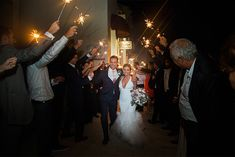 A fun exit for the Bride & Groom with guests holding sparklers! Credit: Coordinator: Andrea Famiglietti, Coastal Celebrations, Photography-Brooke Images