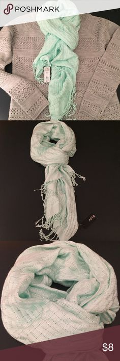 """NWT Mint Green Scarf New with tags in perfect condition! Mint green color with silver detail best shown in cover photo. (Gray sweater is also NWT & for sale, see previous post) Estimated measurements are 70"""" long & 20"""" wide. Apt. 9 Accessories Scarves & Wraps"""