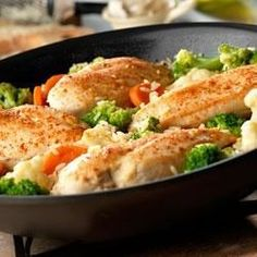 You've got everything you need in just one-skillet . . . garlic-seasoned chicken breasts on a bed of rice mixed with colorful vegetables.  Getting dinner on the table couldn't be easier . . . and it tastes great too.
