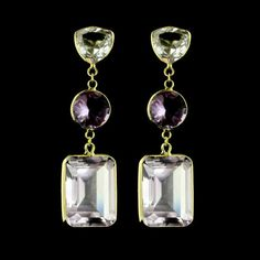 Add a pop of color to your look with these 18K yellow gold blue topaz and amethyst drop earrings