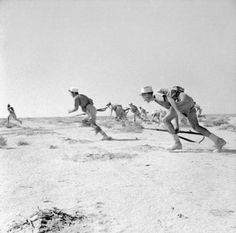 Soldiers in the French Foreign Legion charging in Bir Hacheim, June 1942