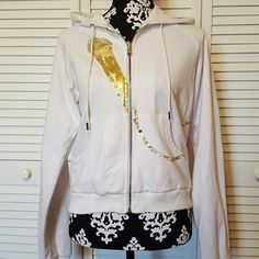 """L.A.M.B Sweatshirt Jacket EUC. White and gold L.A.M.B hooded jacket. Gold microphone printed across front them wrapping behind the jacket spelling out """"i want you all over me like L.A.M.B """".  Gold and silver flowers on microphone cord on back. All trimmings has lightly destressed cuts in them. No damage on jacket.  80%Cotton  20%poly  AA2  Zippered Unstretched Measurements  Bust 39"""" Waist 34"""" Sleeve 26"""" Length 22"""" L.A.M.B. Jackets & Coats"""