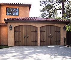 Carriage House Garage Doors. Hurricane Protection. Gulf Coast Shutter