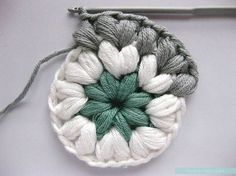 Crochet puff stitches in the round. Sweet.