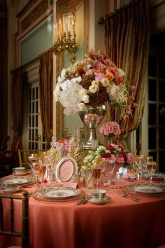 Lovely...like the raised arrangement; gives more oomph to the table.