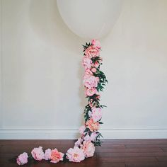 Step 1:Inflate theballoonwith helium to desired fullness and tie a long string to the base. Trim all theflowerheads andgreenery.Step 2:Start by taking s