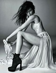 Strong seductive look and leg angles in this black and white fashion photograph.