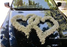 Fioreria Oltre/ Baby's breath wedding car decoration/ Floral hearts