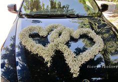 Fioreria Oltre/ Baby's breath wedding car decoration/ Floral hearts