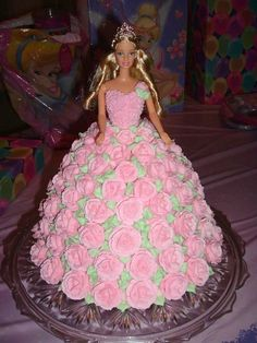 """Barbie Birthday Cake with Roses I used Wilton's wonder mold with one high round cake underneath. This allows the dress to be the correct height for """"Barbie"""" to placed inside. The cake was based upon the cake in Wilton's 1998 yearbook. Bolo Barbie, Barbie Cake, Barbie Dress, Barbie Doll Birthday Cake, Birthday Cake Roses, Barbie Party, Birthday Cakes, Fancy Cakes, Cute Cakes"""