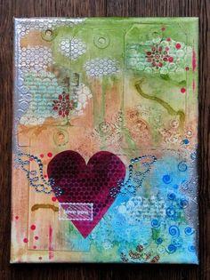 Today I want to share with you a little love canvas I created for the WOW! I first covered the canvas with tags, a doily and pieces of book paper. Love Canvas, Mixed Media Canvas, Canvas Art, Heart Canvas, Art Journal Pages, Art Journaling, Altered Canvas, Creative Portraits, Ideas