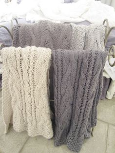 loosely knit... cable and yo's throws... i imagine them in alpaca.... sigh...