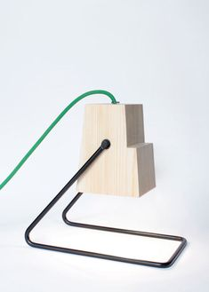 These 360° table lamps by Magdalena Chojnacka / Studio Bongo Design are made from a single block of wood and a simple powder-coated rod.