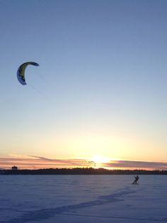 Smowboard wind surfers on the frozen lake. Helsinki Finland