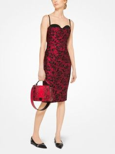 Crafted from a romantic rose silk jacquard, this sheath dress is designed with a chic layered effect. The coordinating belt defines the waist, while an exposed back zipper instills it with subtle edge. Wear it to a cocktail party with pointed-toe flats and a tailored handbag.