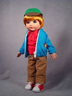 ©Mary Engelbreit Off To School Michael 2007 Robert Tonner DRESSED DOLL T7-AEDD-01 LE400 Originally Sold For $99.99 OUTFIT ONLY T7-AEOF-01 Original price: $59.99 Cotton shirt with corduroy pants and knit jacket; includes cap, socks, sneakers, slingshot, and resin 'pet' mouse.