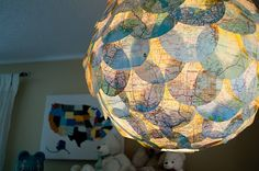 map circles on a light fixture.. would be fun with book illustrations, music, paint chips (?)