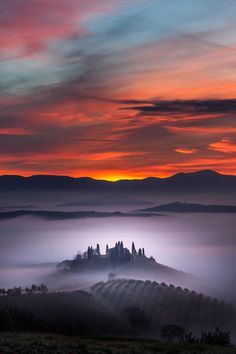 A building emerges from the early morning fog in Belvedere farm in San Quirico d'Orcia, Tuscany, Italy. (Photo by Alberto Di Donato/HotSpotM...