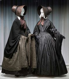 """Two women in full goth garb — one in a black lace veil, the other in a top hat — were gamely posing for tourists' photos on the steps of the Met. They were there, along with more traditionally dressed reporters, to preview the Costume Institute's latest exhibit, """"Death Becomes Her,"""" which opens tomorrow and focuses on mourning fashion from 1815 to 1915."""