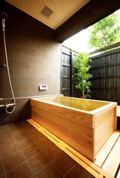 Contemporary Japanese design  bath and shower with traditional elements.