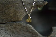 Tiny Gold Hammered Heart Necklace by rhapsodyjewellery on Etsy