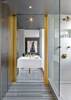 Fashion's Tribe: Messana O'Rorke Gut Renovates Chelsea High-Rise Apartment | Sink and shower fittings in unlacquered brass accent the master bathroom. #design #interiordesign #interiordesignmagazine #architecture #decor #mirror