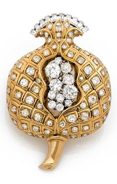 A rare 'Pomegranate' brooch, by René Boivin, circa 1935. Designed as a stylised pomegranate, richly decorated with brilliant-cut and baguette diamonds, mounted in gold and platinum. Signed.
