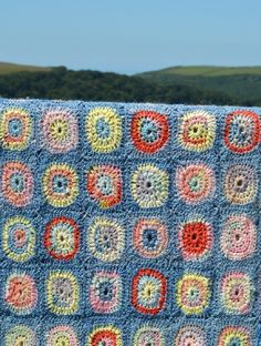 """Circles is one of the blankets featured in **""""Into the West""""** crochet blanket book. Circles is directly inspired by one of my Granny's original Oxfam blankets. She knitted and donated many blankets to Oxfam, hopeing they would bring comfort to starving orphans. You can make this Circles as large or small as you wish. The pattern can be mad using a selection of our Sock or DK yarns and is perfect for using up odd skeins and left over balls."""