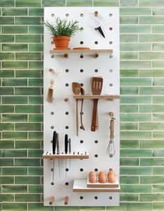 Chef's Edition Peg Board by Kreisdesign on green metro tile - a brilliant modern Scandinavian style kitchen shelving system/organiser - an inexpensive and easy way to add a designer look to your kitchen with special areas to hold knives and utensils, display houseplants and other kitchen essentials as well as hand tea towels. Handcrafted in London.