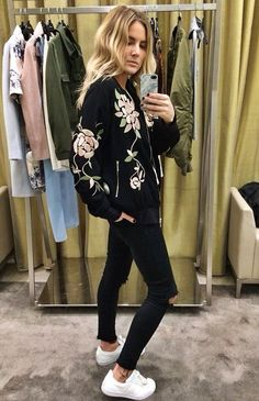Flower bomber jacket, black jeans and white sneakers. Fashion. Style.