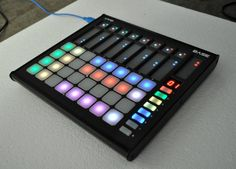 RGB pads plus touch strips: Livid Base controller.