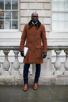 Dress in a brown fur collar coat and a dark blue suit for a classic and refined silhouette. Why not add brown leather monks to the mix for a more relaxed feel?   Shop this look on Lookastic: https://lookastic.com/men/looks/fur-collar-coat-suit-dress-shirt/15387   — White Dress Shirt  — Brown Fur Collar Coat  — Black Leather Gloves  — Green Tie  — Navy Suit  — Brown Leather Monks