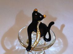 Hey, I found this really awesome Etsy listing at http://www.etsy.com/listing/174677636/black-gold-enamel-vintage-black-cat
