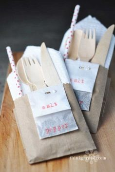 Wrap up everything guests might need in a neat little kraft paper bag pocket, including salt and pepper packets stapled to the side. Perfect for outdoor parties!