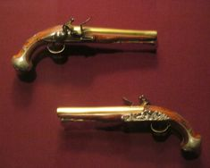 George Washington's original 1748 Hawkins flintlock pistols, on display at West Point Museum.