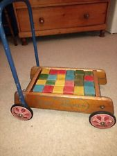 Vintage woodenTriang Babywalker with original wooden blocks and Triang badge.  We had these, and passed them on to my baby!