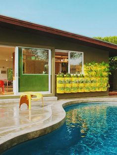 This is Barbara Bestor's place in Silverlake, CA. I love her style, especially her color sense. She's got a magenta front door!