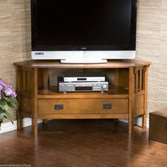 Marvellous Corner Media Cabinet Design Ideas Come With Varnished Wooden Media Cabinet In Cherry Feature Silver Modern Player And Storage Drawer Also Ring Pull a part of  under Furniture