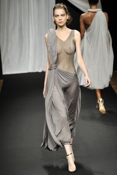 4.Roman Under Tunic/Palla - Anne Valerie Hash ; Spring/Summer 2009 RTW Hash converts the modesty of the traditional roman under tunic and palla by exposing the waist and chest with a sheer fitted slip.Similarly, the over shoulder draping and fluidity of silk on the form could translate into the regal end of roman silk tunic and pallas.