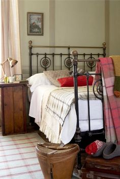Solid bedding with easy plaid blankets for accents....very cute!  Love the bedside table:)