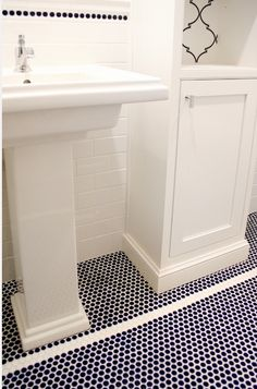 LOVE!  navy blue dot tiles, white mortar, accent line of dots,wht subway, modern hardware,and moroccan design within cabinets!