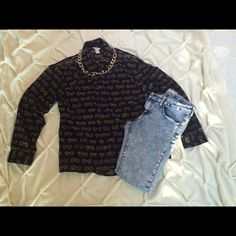 Long sleeve top Long sleeve black sheer button up top with cut out shoulder. Has yellow and purple sunglasses on the shirt Forever 21 Tops Button Down Shirts