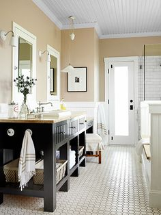 Penny tile floor, beautiful single-sink console, and a door that opens right up to the pasture outside.